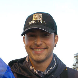 Crew Member of Sound Leader Seafoods with cap